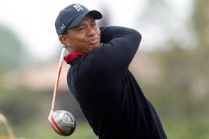 A strange year for Tiger Woods took another bizarre twist Sunday when a fan was arrested for running toward the ...