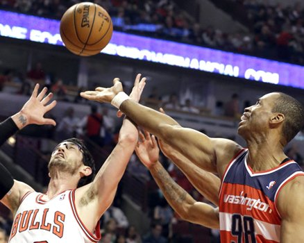 Washington Wizards center Jason Collins, right, battles for a rebound against Chicago Bulls guard Kirk Hinrich during the first half of an NBA basketball game in Chicago, April 17.