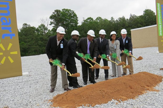 "Walmart and DeKalb officials broke ground for the new ""Neighborhood Market"" on Panola Road on May 1."