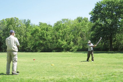 Bobby Williams and Les Farr say the greens at Sugar Creek are showing signs of improvement.