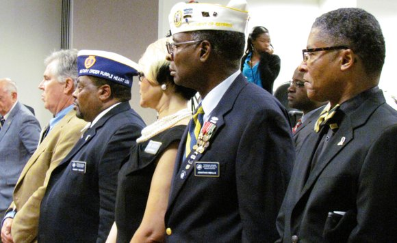 """A lone bugler played """"Taps"""" as DeKalb County officials, residents and family members stood in somber silence."""