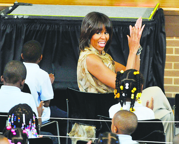 """First lady Michelle Obama visited students at Savoy Elementary School in Southeast on May 24. She congratulated students regarding the nationwide """"Turnaround: Arts – Creating Success in Schools"""" program in the District."""