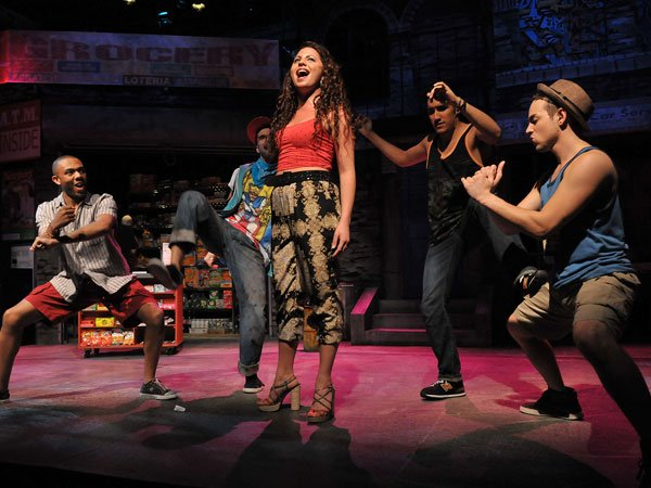 "Vanessa, played by Alessandra Valea (center), is the main character's love interest in ""In the Heights."""