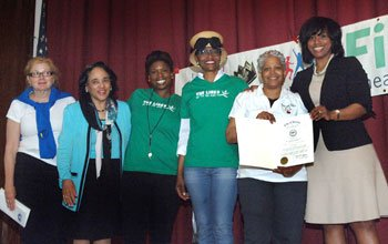 Boston City Councilor Ayanna Pressley (far right) presented a City Council resolution co-sponsored by Councilor Tito Jackson recognizing the Fit for the King Urban Field Day at Dorchester's Martin Luther King K-8 School. She was joined by (L to R): Joann Flaminio, Boston Athletic Association; Carol Johnson, superintendent of Boston Public Schools; Stephanie Anderson Garrett and Pam Everhart of The Links, Inc. and Jessica Bolt of the King K-8 School.