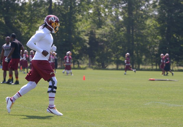 Washington Redskins quarterback Robert Griffin III trained with light running and throwing the football during the organized team activity at Redskins Park in Ashburn, Va., Thursday, May 30.