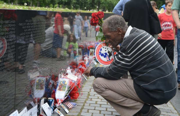 A visitor paying respects at the Vietnam Memorial on Monday, May 27, 2013.