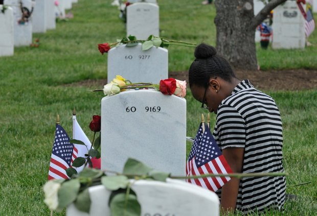 Remembering a loved one at Arlington Cemetery Monday, May 27, 2013.