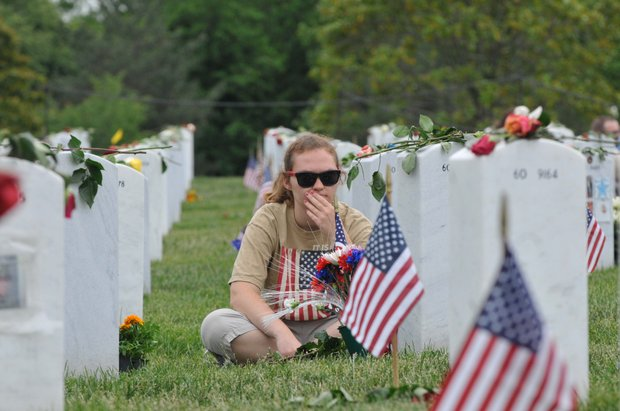 Remembering a soldier at Arlington National Cemetery on Monday, May 27, 2013.