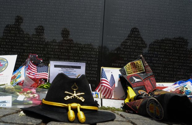 1st Cavalry Division hat  at the Vietnam Memorial Wall on Monday, May 27, 2013.