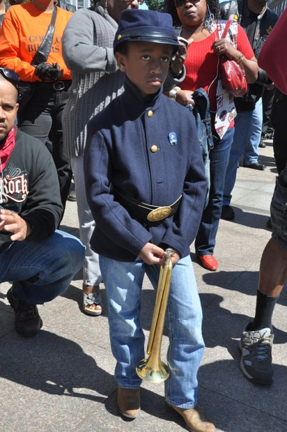 Young Buffalo Soldier, E.T. holding his Bugle during a tribute to veterans at the African American Civil War Memorial on Sunday, May 26, 2013 in Northwest.