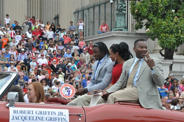 Robert Jr. and Jacqueline Griffin with Washington Redskins Quarterback Robert Griffin III as Honorary Grand Marshals during the Ninth Annual National Memorial Day Parade on Monday, May 27, 2013 in Northwest.