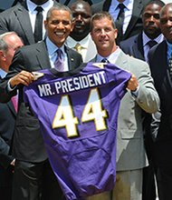 Ravens General Manager, Ozzie Newsome gave President Barack Obama, the 44th president of the United States, the traditional team jersey emblazoned 