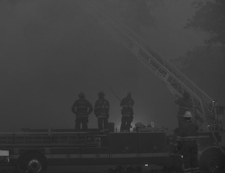 Smoke from the four-alarm fire that destroyed Frager's Hardware, a Capitol Hill landmark, shadowed the daylight as firefighters fought the blaze on Wed., June 5.