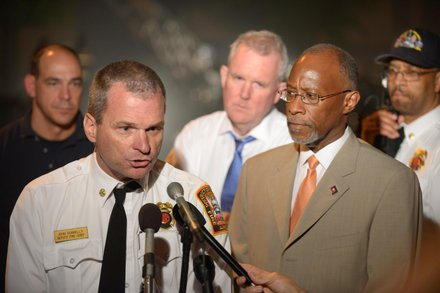 D.C. Fire/EMS Deputy Fire Chief John Donnelly (left), with Deputy Mayor Paul Quander Jr. speaks to the media about the four-alarm blaze that destroyed Frager's Hardware in Southeast on Wed., June 5.