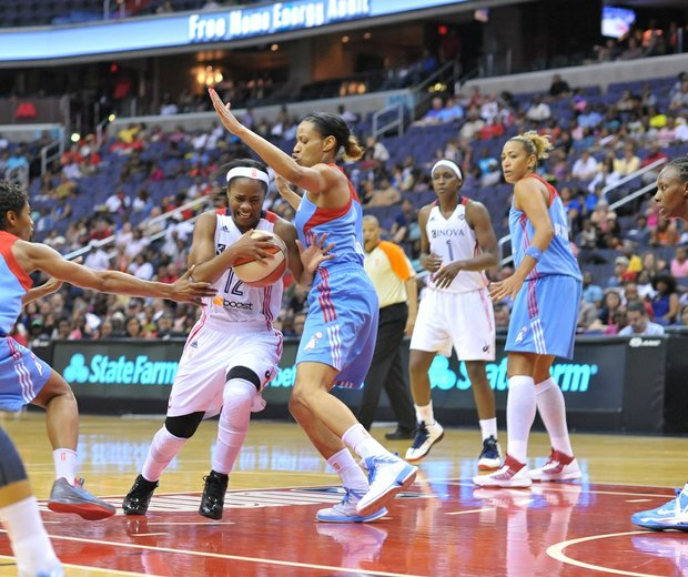 Mystics guard Ivory Latta drives past former Mystics and current Atlanta guard Jasmine Thomas on Sunday, June 2 at the Verizon Center in Northwest. Latta finished the game with 14 points and 7 assists. Atlanta defeated Washington 73-63.