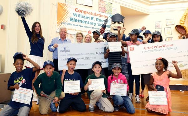 New England Patriots Chairman and CEO Robert Kraft awarded William E. Russell Elementary School Principal Tamara Blake-Canty with a surprise donation, matching a prize from the national Find Your Balance Challenge, to purchase the school a much-needed new kitchen. William E. Russell Elementary School in Dorchester was selected as the grand prize winner of the Find Your Balance Challenge by kickstarting a school-wide wellness initiative, working with students across all grades to create a community garden and form a student wellness council.