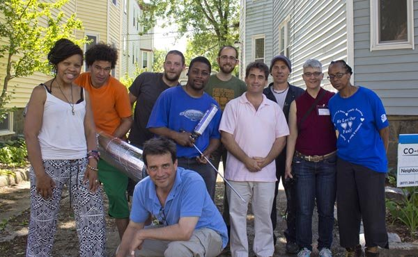 City Councillor Frank Baker and environmental advocate Joel Wool posed with members of Co-op Power, a multi-class, multi-racial movement for a sustainable and just energy future, as they came together to weatherize a property in the Bowdoin-Geneva area of Dorchester.