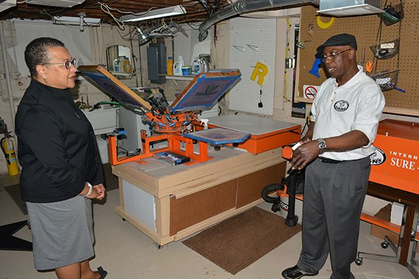 """Willie Armstrong of Armstrong Custom Signs with Marie Johns, Deputy Administrator for the U.S Small Business Administration during Johns' """"Quadrant Tour"""" on Thurs., May 23 in Southwest."""