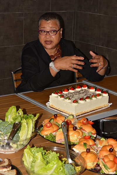 U.S. SBA Deputy Administrator Marie Johns enjoys cake at Wagshal's in Northwest on Thurs., May 23.