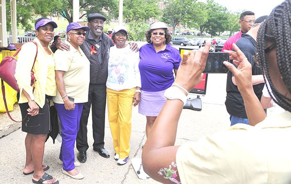 Golfing pioneer Calvin Peete (center) poses with a few lady golfers during a photo op at the 2013 Langston Golf Heritage Celebration on Sat. June 8 in Northeast.