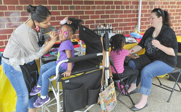 Children enjoy face painting at the Langston Golf Heritage Celebration on Saturday, June 8 in Northeast.
