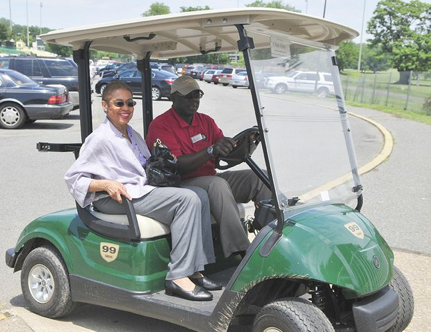 Congresswoman Eleanor Holmes Norton an honorary guest at the Langston Golf Heritage Celebration held in Northeast in a golf cart driven by Mack McCauley.