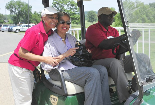 Shirley Washington, president of the Langston Junior Boys and Girls Golf Club welcomes Congresswoman Eleanor Holmes Norton to the 2013 Langston Golf Heritage Celebration on Sat., June 8 in Northeast.