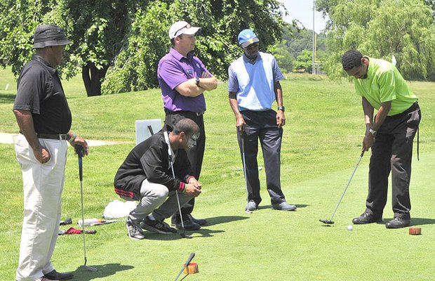 Guests at the Langston Golf Heritage Celebration participate in outdoor golf activities on Saturday, June 8 in Northeast.