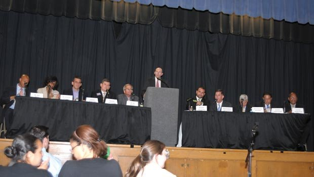 The crowded race to replace Mayor Thomas Menino is underway as ten hopefuls debated issues of public education at a forum last week at the Edward Brooke Charter School in Roslindale. After the debate, Barros, Richie, Ross, Connolly, Walczak, Arroyo, State Rep. Marty Walsh, Suffolk County District Attorney Daniel Conley and City Councillors Rob Consalvo and Charles Yancey flanked moderator Chad D'Entremont at the podium.
