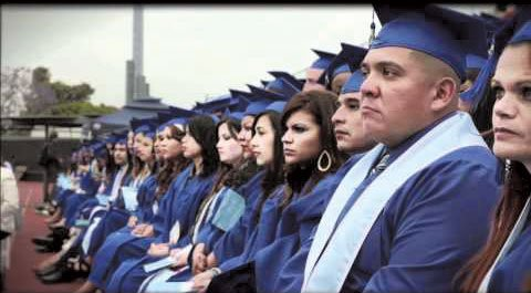 Santa Monica College graduates and their families, along with administrators and faculty, paused for a moment of silence during commencement ...