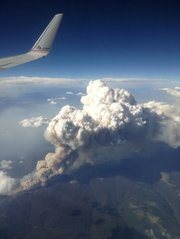 CNN iReporter Randy Kirton shot an image of smoke billowing from the fires in Colorado — all the way to his window on his flight to San Fransisco.