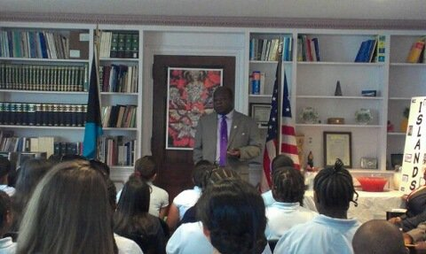 Elliston Rahming, Bahamian ambassador to the District, addresses fifth-grade students from Takoma Education Campus at a luncheon held for the students at the Bahamian Embassy on June 11.