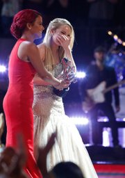 "Christina Millian, left, congratulates ""The Voice"" winner Danielle Bradbery."