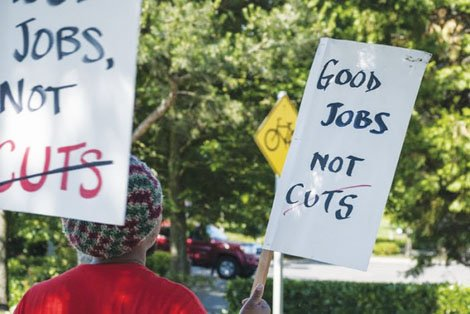 Postal workers protest increasing privatization of their jobs.