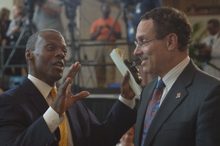 Former Rep. J.C. Watts Jr. (R-Okla.) with D.C. Mayor Vincent Gray (D) at the Frederick Douglass statue unveiling held at the U.S. Capitol June 19.