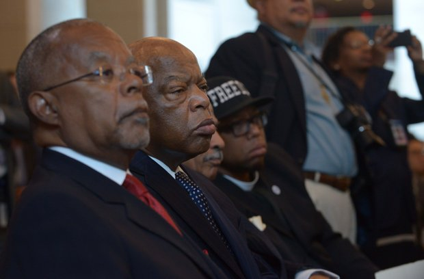 (Left to right): Prof. Henry Louis Gates, Rep. John Lewis (D-Ga.), Rep. John Conyers Jr. (D-Mich.) and Rev. Lennox Yearwood during the Frederick Douglass statue unveiling at the U.S. Capitol on June 19.