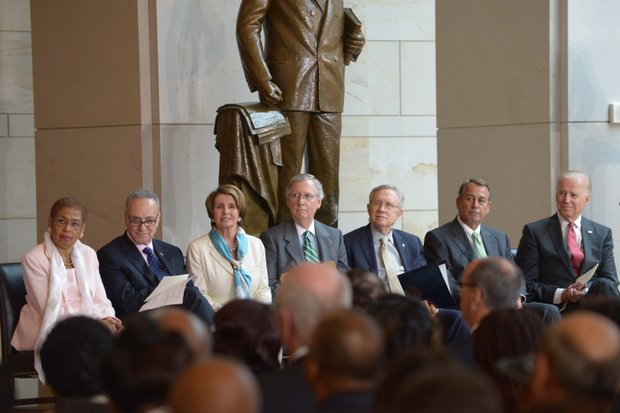 (Left to right) D.C. Delegate Eleanor Holmes Norton (D), Sen. Charles Schumer (D-N.Y.), House Minority Leader Nancy Pelosi (D-Calif.), Senate Minority Leader Mitch McConnell (R-Ky.), Senate Majority Leader Harry Reid (D-Nev.), House Speaker John Boehner (R-Ohio) and Vice President Joseph R. Biden (D) at the Frederick Douglass statue unveiling held at the U.S. Capitol on June 19.