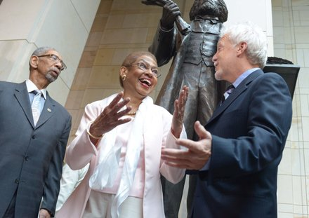 D.C. Delegate Eleanor Holmes Norton (D) with Steven Weitzman (right), designer of the Frederick Douglass statue during the statue unveiling ceremony at the U.S. Capitol on June 19.