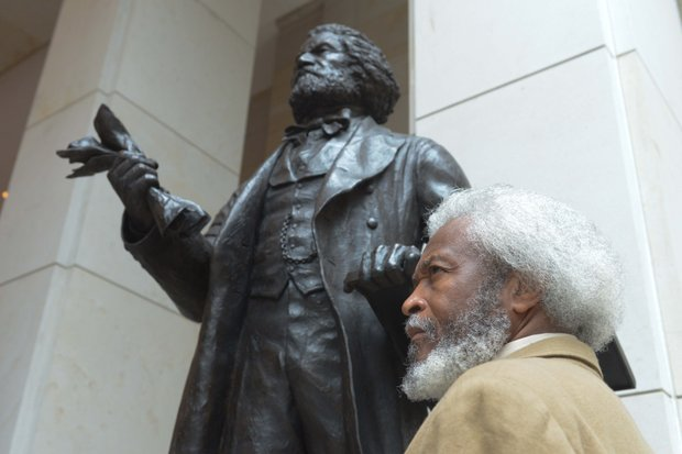 Michael Crutcher Sr., a Frederick Douglass impersonator from Nicholasville, Ky. attends the Frederick Douglass statue unveiling at the U.S. Capitol on Wed., June 19.
