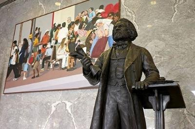 Slave-turned-abolitionist Frederick Douglass now has a bronze statue in the U.S. Capitol's Emancipation Hall.