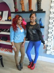 Shione Murray, employee, and Alicia Walton, owner of Fetysh Shoes in Rosindale.
