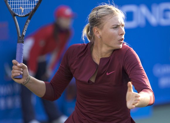 Maria Sharapova only wanted to talk tennis after coming through a testing opening match at Wimbledon Monday against promising young ...