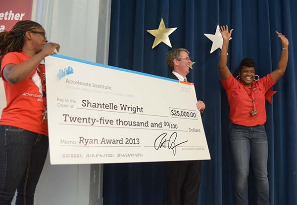 Shantelle Wright, founder and administrator of Achievement Prep Academy in Southeast, recently received a check for $25,000 from patrick G. and Shirley W. Ryan Foundation.
