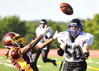 Washington Divas player Brooke Coley catches a pass from her quarterback during the second round of Eastern Conference playoff action at the Prince George's Sports and Learning Complex in Landover, Md., on Saturday, June 22. Quarterback Allyson Hamlin scored five touchdowns – four through the air and one on the ground – and linebacker Trigger McNair added a pair of defensive plays. The Divas won their conference quarterfinal game over the Columbus Comets 40-12.