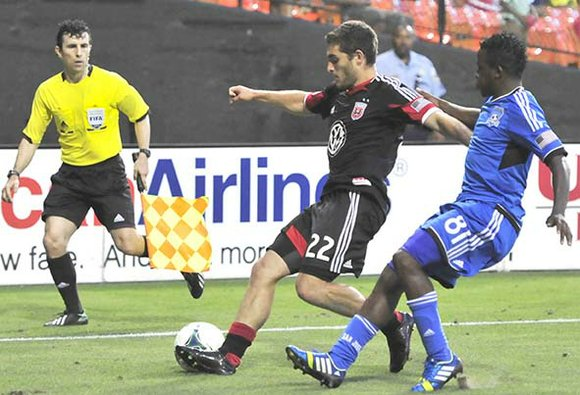 D.C. United defender Chris Korb, and San Jose Earthquakes midfielder Marvin Chavez, battle for the soccer ball.