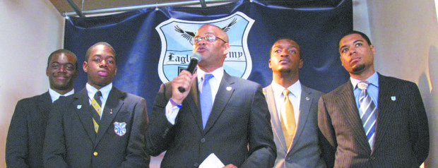 David C. Banks, welcomed the community and introduced some proud graduates of  the Eagle Academies. L to R: Jennings McCarty (class of 2013), Fordham University; George Nuñez (class of 2013), SUNY Potsdam; vBanks, Eagle Academy Foundation president and CEO; Christopher Graham (class of 2010), Claflin University; and Juan Rifkogel (class of 2008), Union College.