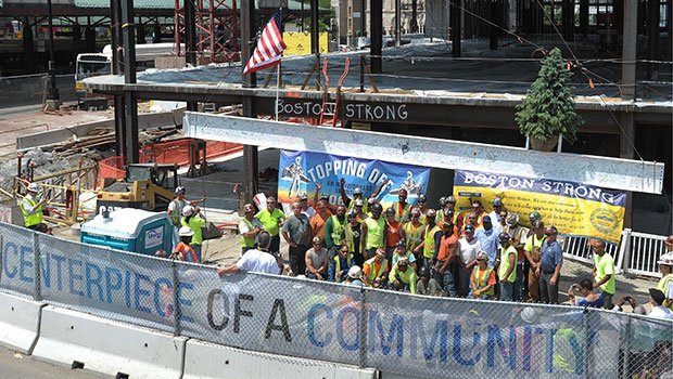 Surrounded by elected officials, community activists and members of the building trades, Mayor Thomas M. Menino celebrated the raising of the final piece of steel on the Ferdinand Building in Dudley Square.