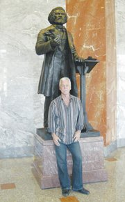 Artist Steven Weitzman stands in front of the Frederick Douglass statue. (Courtesy of Steven Weitzman Studios)