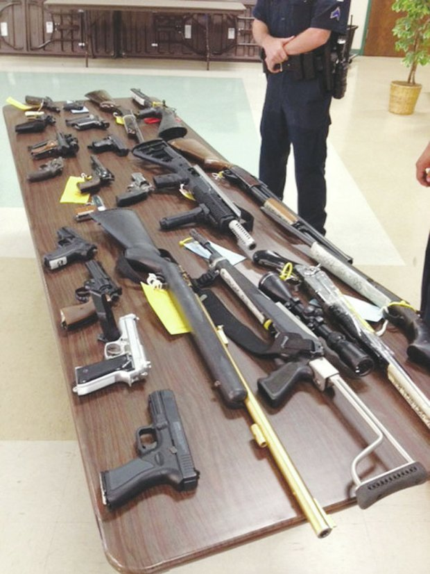 "During a ""Gift Cards for Guns"" event on June 22 in Forest Heights, Md., more than 50 firearms were turned in. Participants received gift cards in varying amounts. (Courtesy Photo)"