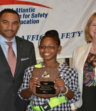 Baltimore City student, Kiara Gordon of Abbottston Elementary School in Baltimore City was one of 14 Student Patrollers out of nearly 30,000 Patrollers in Maryland to be honored with the 2013 Outstanding School Safety Patrol Award. (Left to right) Marke Dickinson, Executive Vice President, AAA Mid-Atlantic Kiara Gordon, Abbottston Elementary School student; and Myra Wieman, Safety Services Manager, Mid-Atlantic Foundation for Safety and Education